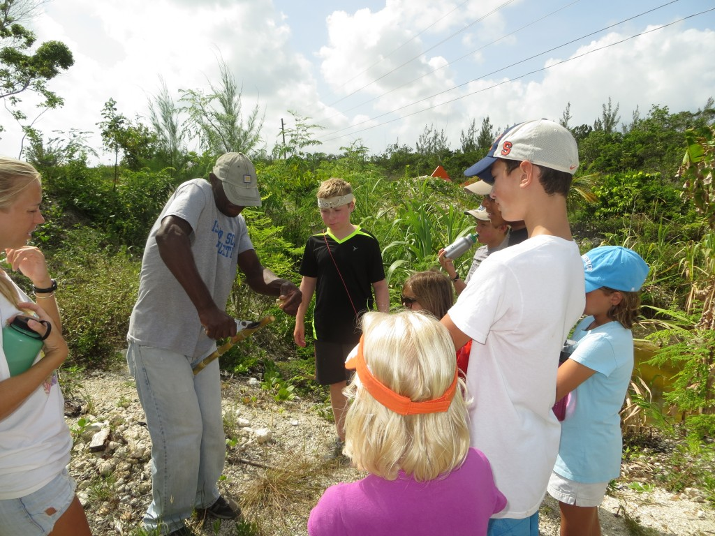 Students getting a tour of the farm with Joseph