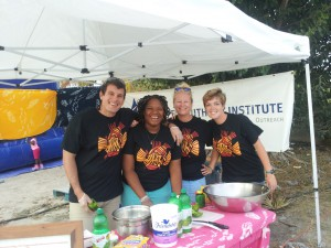 Part of the team working the CEI booth: Aaron, Tamanji, Liz and Alicia