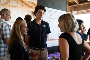 Students on the lionfish team discuss their project with Dr. Stephanie Green.