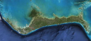 The Island of Grand Bahama.  The dark blue color on the south side of the island indicates deep water.  The red line is the Grand Lucayan Waterway built in the 70's that connects the north and south side of the island.