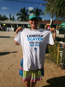 Ann holds up the lionfish slayer t-shirt she won in a drawing after signing up for The Cape Eleuthera Institute updates and newsletter