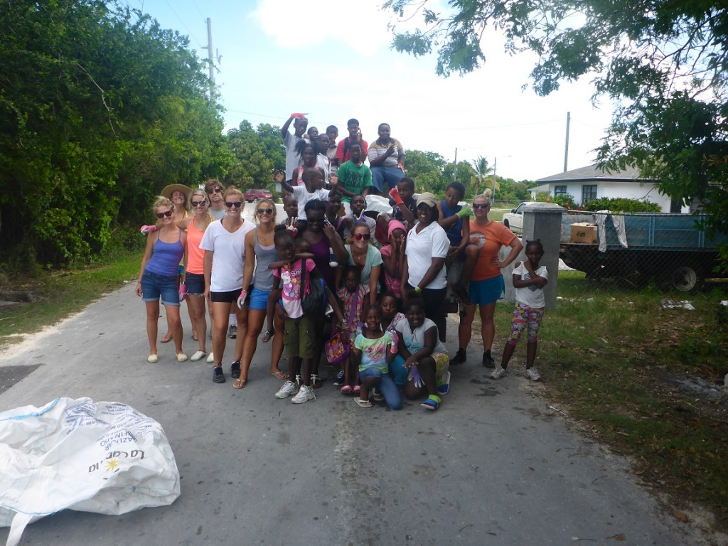 The clean up team posing in front of one of the truckloads of trash collected.