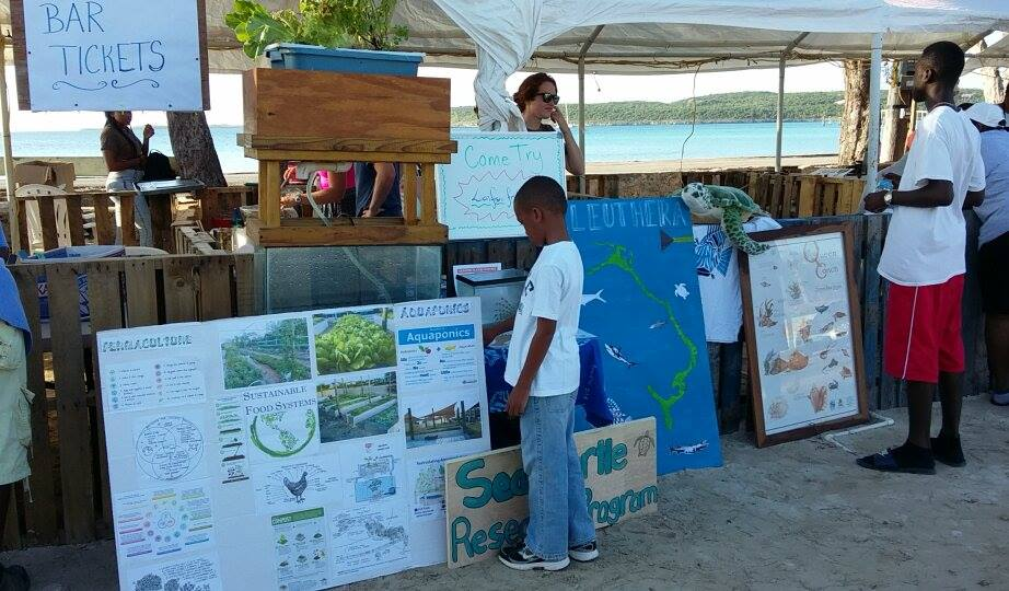 The CEI booth with information on lionfish, queen conch, sea turtles, and aquaponics
