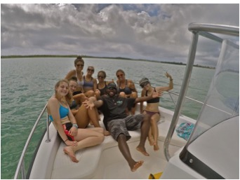 The sea turtle team and Julius aboard his boat in Savannah Sound.